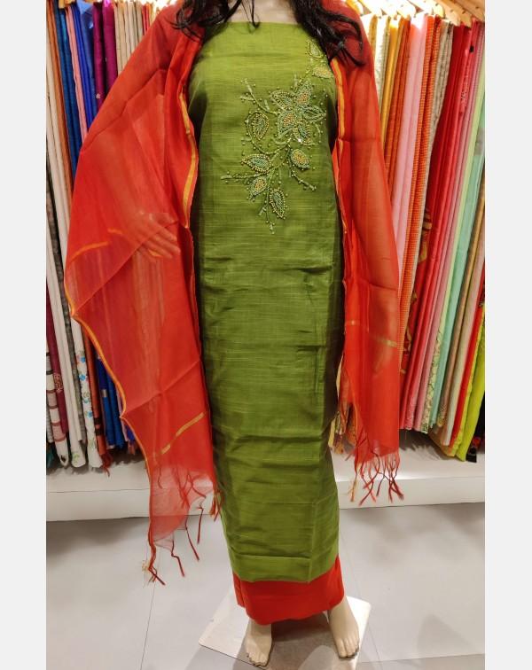 Handworked olive green semi silk salwar set.