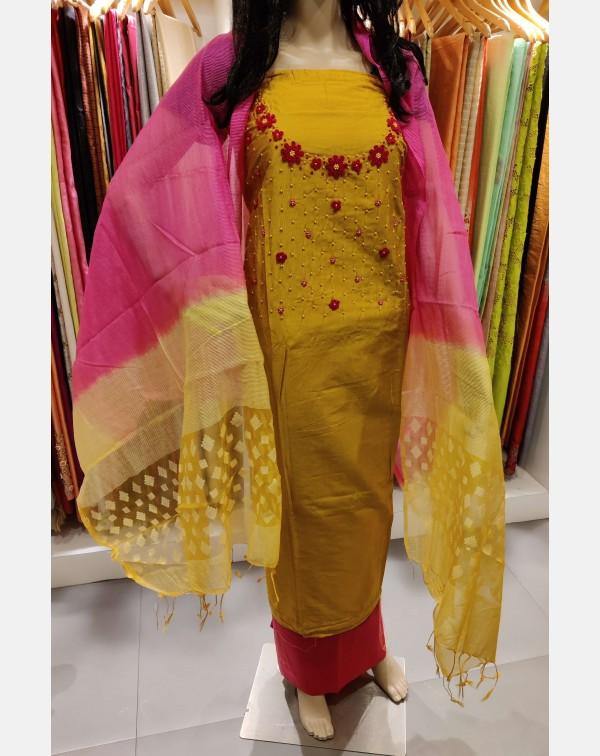 Handworked mustard semi silk salwar set.