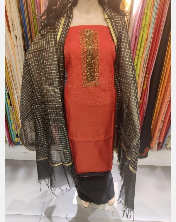 Red handworked semi silk salwar set.