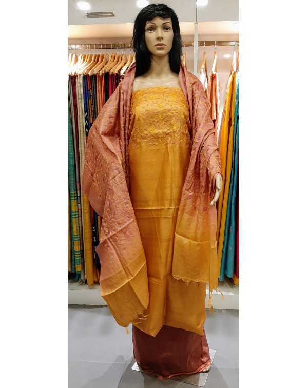 Embroidery work on tussar silk salwar set.