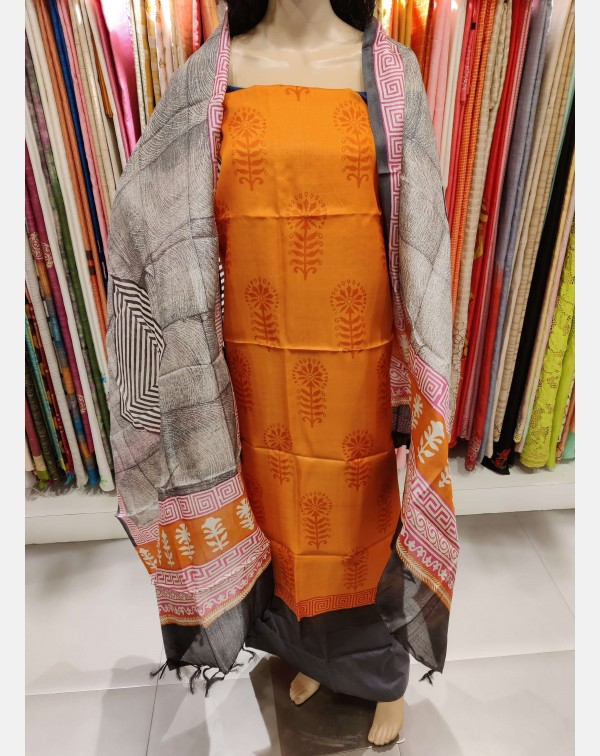 Block printed orange tissar silk salwar set