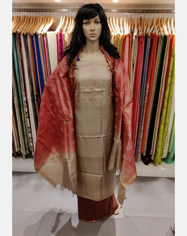 Embroidery work on dark beige Tussar silk salwar s...