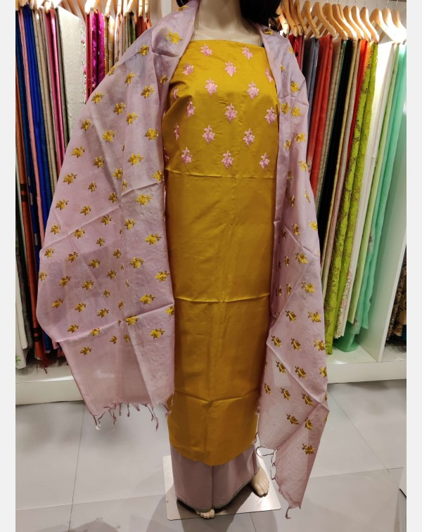 Embroidery work on mustard Tussar silk salwar set