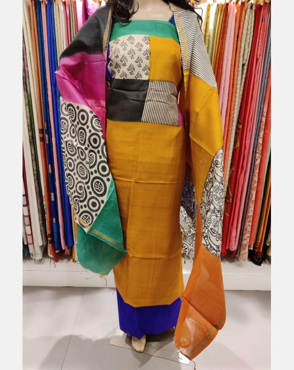 Printed mustard Tussar silk salwar set.