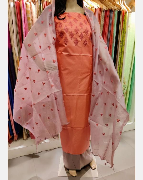 Embroidery work on peach Tussar silk salwar set.
