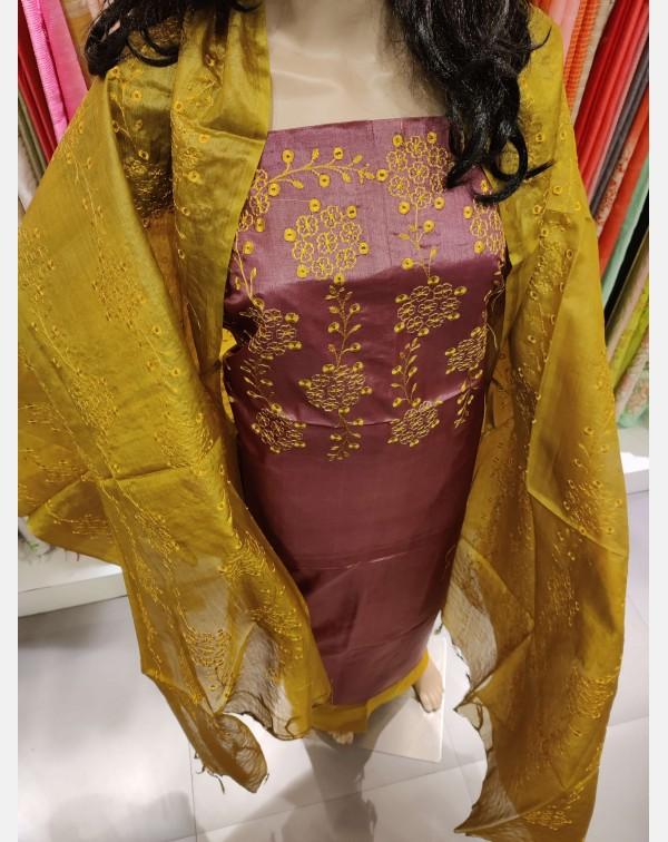 Embroidery work on purple Tussar silk salwar set.