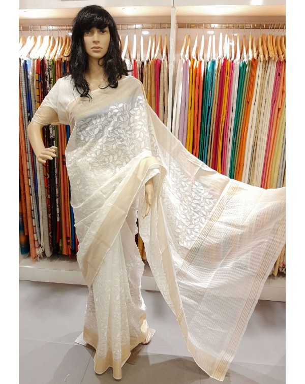 Embroidery work on off white chanderi saree.