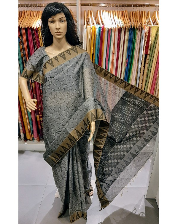 Grey cotton saree with temple border.