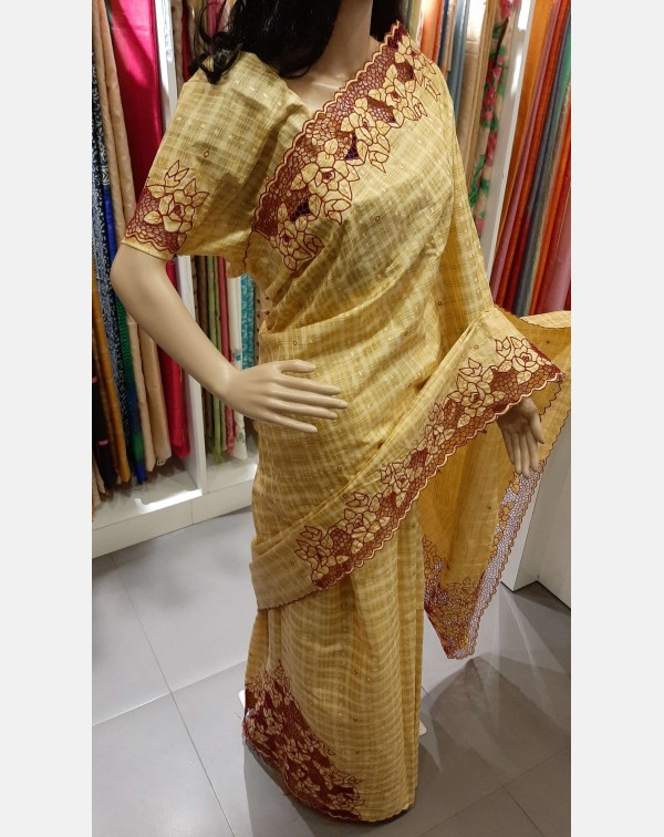 Twine cutwork on handloom tussar silk saree.