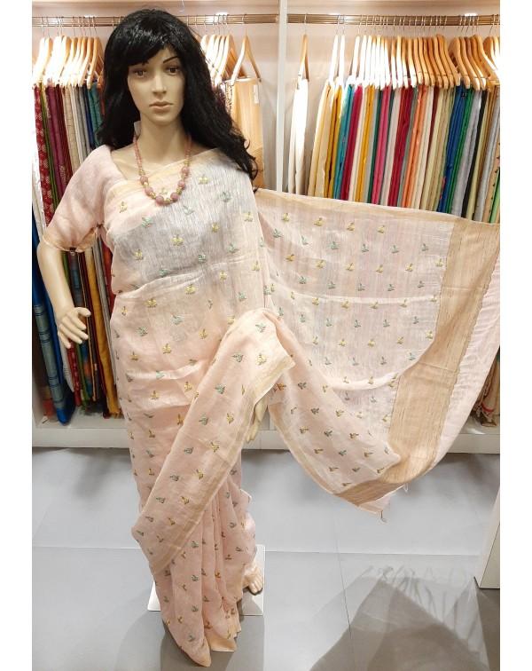Embroidery work on linen silk saree.