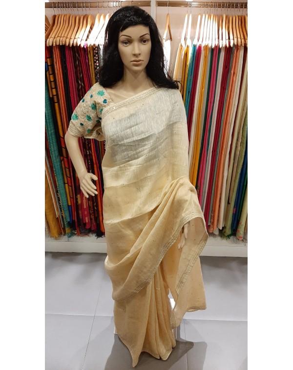 Sequence work on linen silk saree.