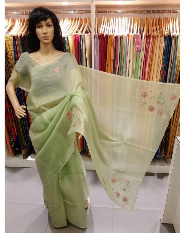 Shadow work on green organza saree.