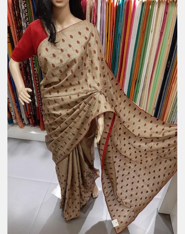 Embroidery work on semi silk saree.