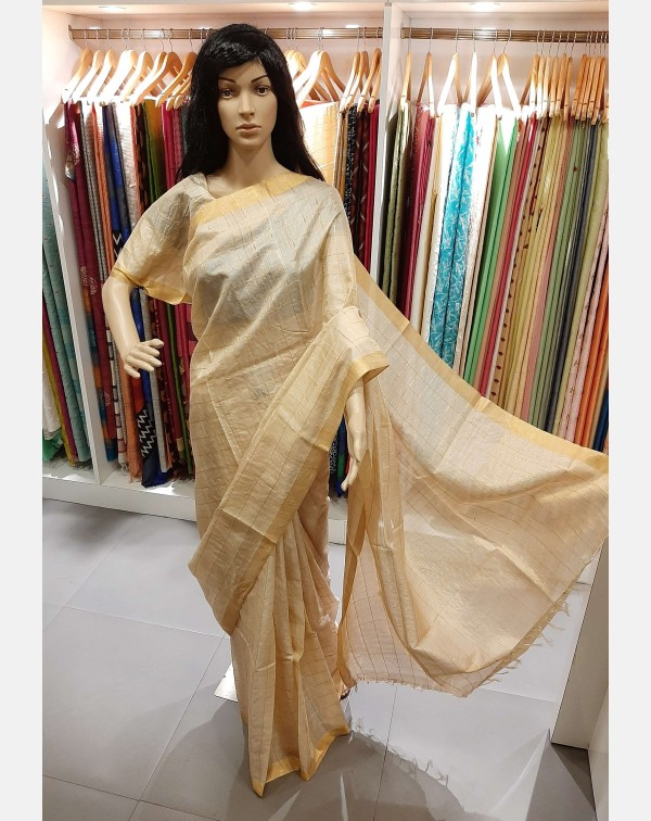 Beige tussar silk saree with check jerry weaving.