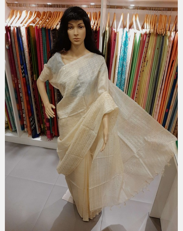 Off white tussar silk saree with jerry and sequenc...