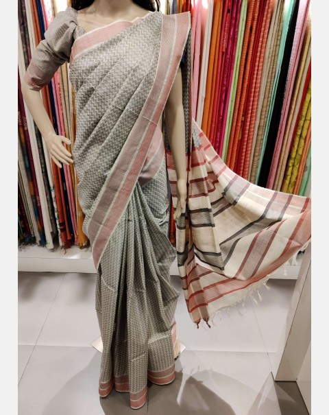 Off white tussar silk saree with black zigzag weaving