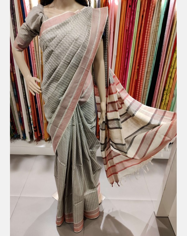 Off white tussar silk saree with black zigzag weav...