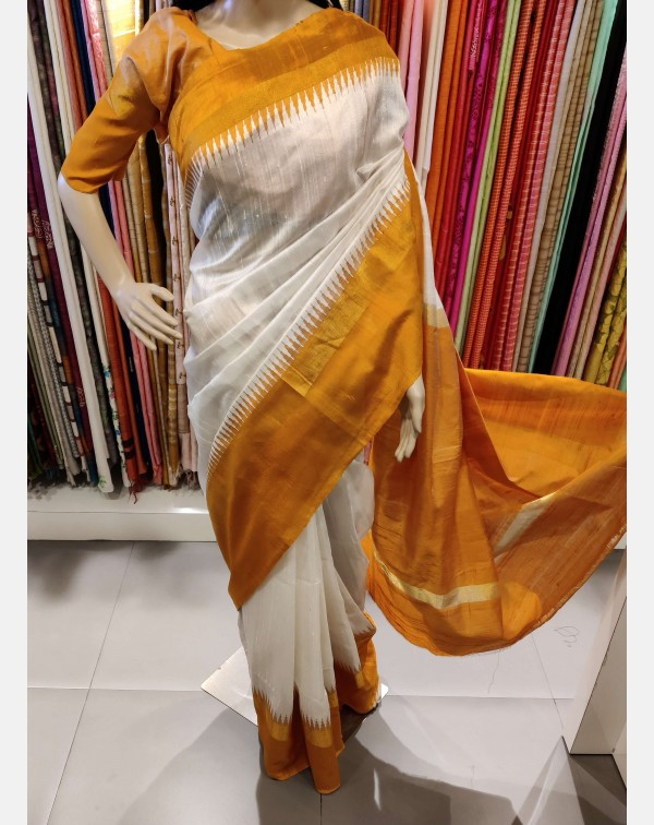 Off white raw silk saree with temple border