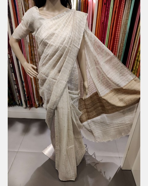 Off white tussar silk saree.