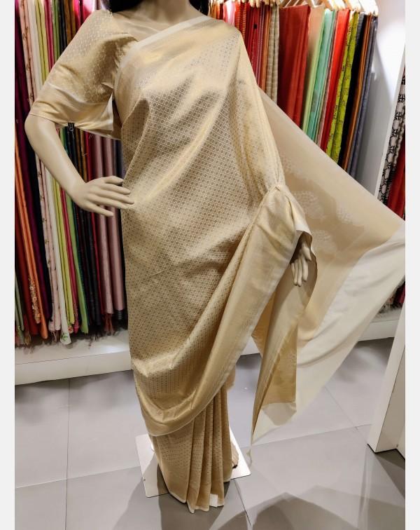 Golden weaving on off white Brocade silk saree