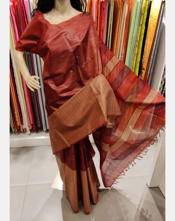 Maroon Tussar silk saree with one side broad borde...