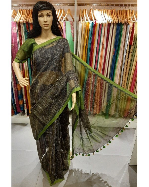 Black jute silk saree with green border.