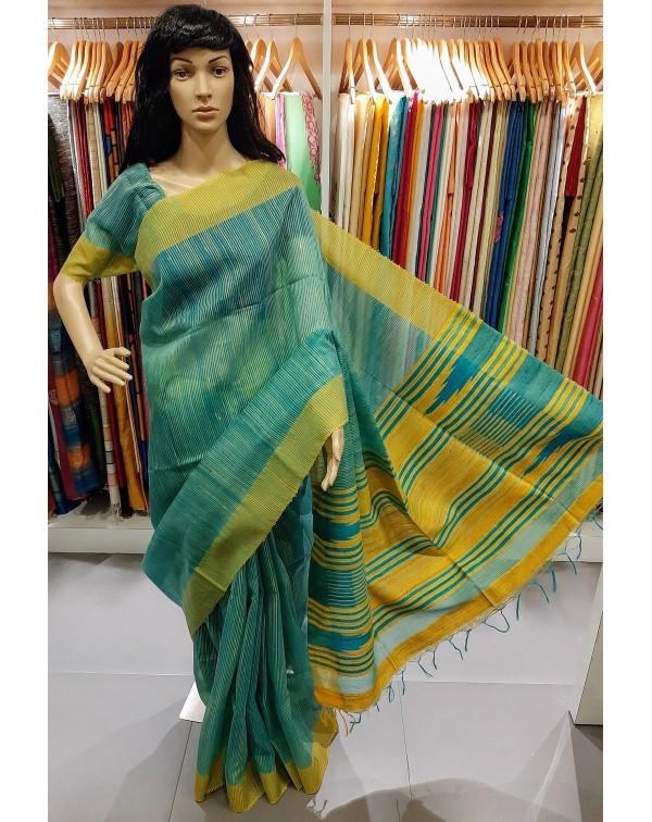 Blue tussar jute silk saree with light yellow bord...