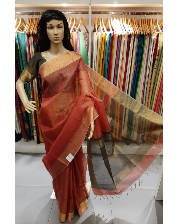 Red and gold double shade tissue saree.